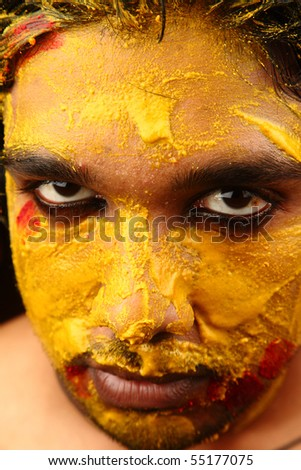 An yellow colored face looking straight - stock photo