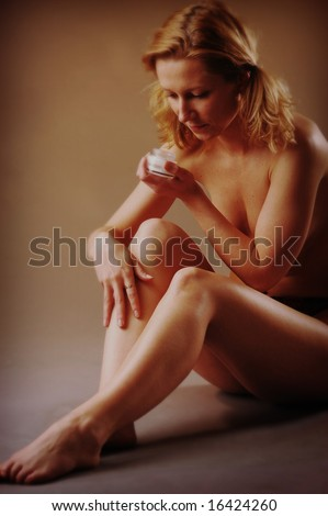 An young blond woman taking care of her beauty