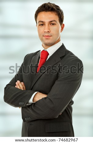 an young business man portrait at the office - stock photo