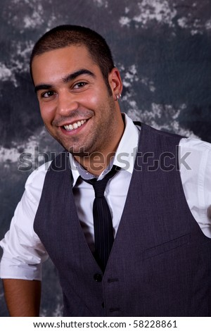 an young happy businessman, close up portrait - stock photo