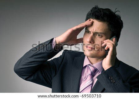 An young irritated man on phone