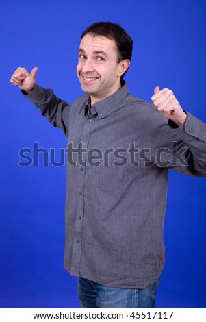 an young man portrait over a blue background - stock photo