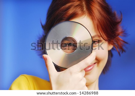 An young pretty girl holding a CD