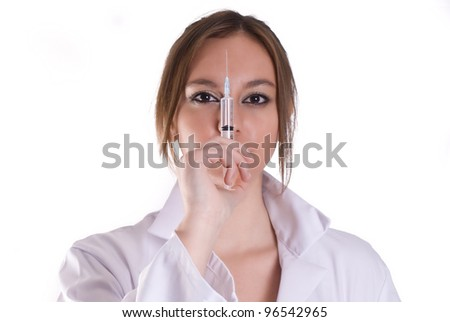 An young woman nurse with syringe