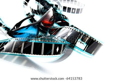 Anachrome plastic 3D imaging glasses on film strip, 3-d experience - stock photo
