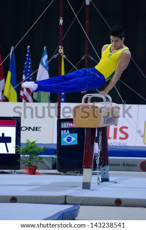 ANADIA, PORTUGAL - JUNE 21: Arthur Mariano (BRA) during the Art Gymnastics FIG World Cup Challenge on june 21, 2013 in Anadia, Portugal.