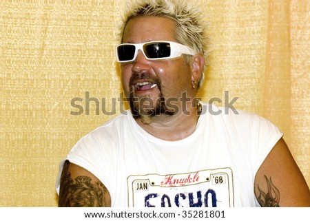 ANAHEIM, CA - AUGUST 8: America's Rock N Roll chef Guy Fieri attend Celebrity Food Show at Hilton Anaheim Hotel August 8, 2009 in Anaheim, CA. - stock photo