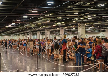 Anaheim, CA -  June 22: Fans line up for their pass to VidCon's 6th annual conference where YouTube creators and fans attend at the Anaheim Convention Center in Anaheim, California on June 22, 2015 - stock photo