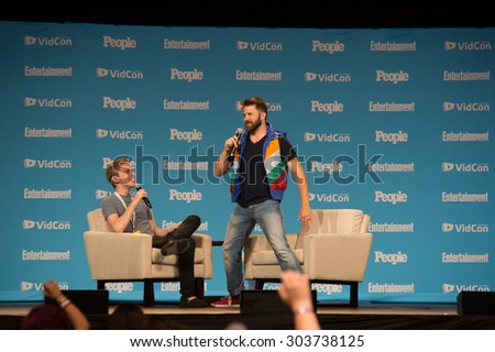 Anaheim, CA - June 23: People Magazine's Joe Bereta (R) interviews online celebrity Jon Cozart at VidCon 2015 at the Anaheim Convention Center in Anaheim, California on June 23, 2015 - stock photo