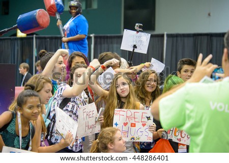 Anaheim, CA - June 24: Some attendees offer free hugs at VidCon 2016 for YouTube creators, influencers and fans at the Anaheim Convention Center in Anaheim, California on June 23, 2016