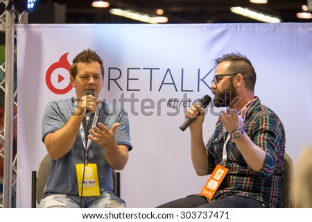 Anaheim, CA - June 23: TJ Chambers (R) interview internet celebrity Jake Vale at the VidCon conference at the Anaheim Convention Center in Anaheim, California on June 23, 2015 - stock photo