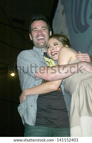 ANAHEIM, CA - MARCH 31: Colin Donnell and Willa Holland pose for photos after a panel discussion at the 2013 Wondercon convention on March 31, 2013 in Anaheim, CA.