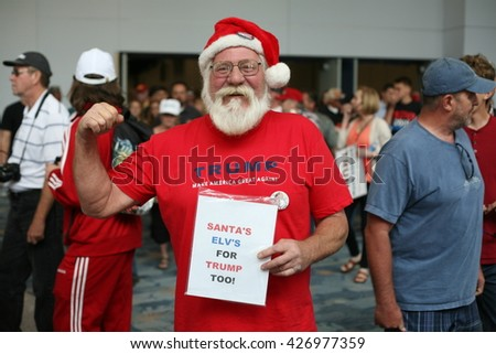 ANAHEIM CALIFORNIA, May 25, 2016: A man dressed as Santa Claus shows his  support for Presidential Candidate Donald J. Trump at the Anaheim Convention Center rally on.  5.25.2016