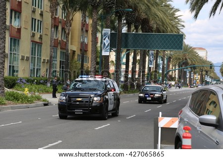 ANAHEIM CALIFORNIA, May 25, 2016: Police in riot gear and cars and vans protect both supporters and protesters from each other during the Republican Nominee Donald J. Trump Rally Anaheim 5.25.2016