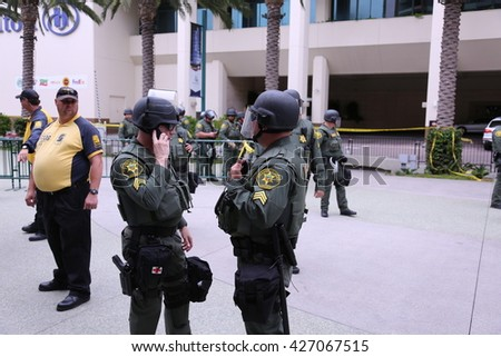 ANAHEIM CALIFORNIA, May 25, 2016: Police in riot gear and in cars  protect both supporters and protesters from each other during the Republican Nominee Donald J. Trump Rally Anaheim 5.25.2016 - stock photo