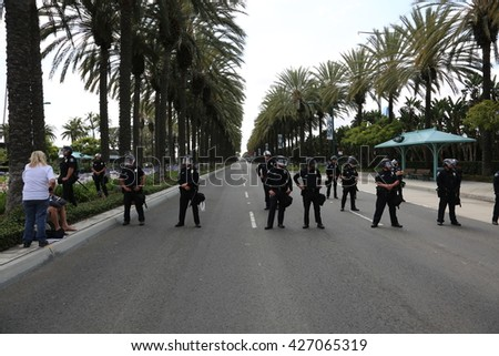 ANAHEIM CALIFORNIA, May 25, 2016: Police in riot gear and on horse back protect both supporters and protesters from each other during the Republican Nominee Donald J. Trump Rally Anaheim 5.25.2016  - stock photo