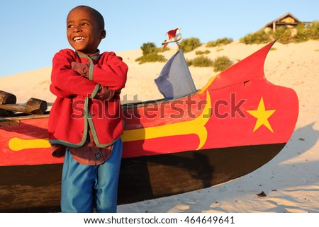 ANAKAO - MADAGASCAR - JUNE 13, 2016: Unidentified happy boy on June 13, 2016 in Anakao, Madagascar. Due to an ongoing political crisis Madagascar is among the poorest counties in the world