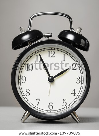 analog alarm clock on white background