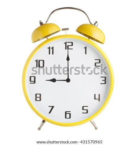 Analog alarm clock showing nine o'clock isolated on white background - stock photo