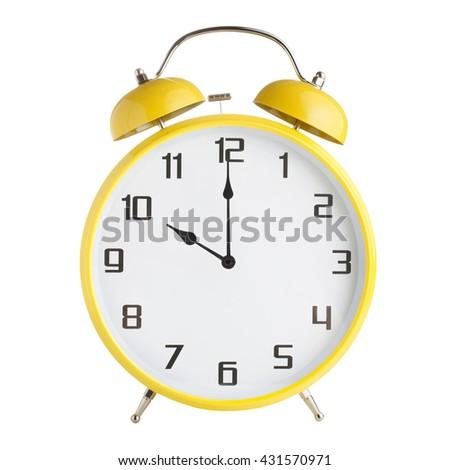 Analog alarm clock showing ten o'clock isolated on white background - stock photo