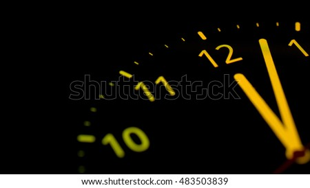 analog clock on telephone display. clock about to 12 midnight or midday, conceptual of New Year and countdown. close up. colorful.