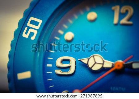 analog  clock set to six fifty - stock photo