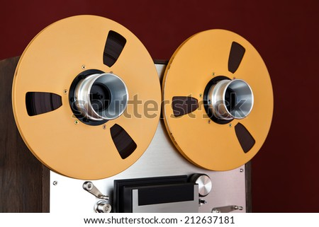 Analog Stereo Open Reel Tape Deck Recorder Spool Closeup - stock photo