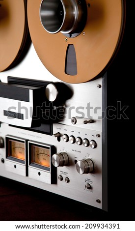 Analog Stereo Open Reel Tape Deck Recorder Vintage Closeup - stock photo
