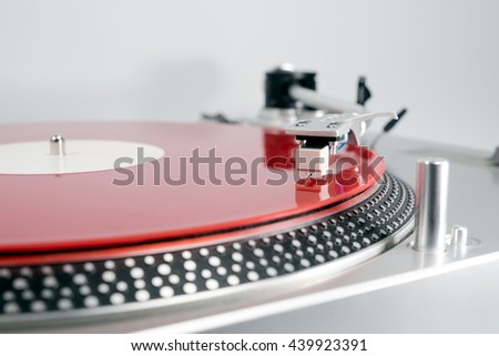 Analog Stereo Turntable Red Vinyl Record Player white Head shell Cartridge - stock photo