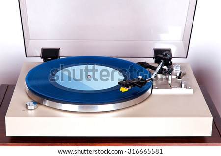 Analog Stereo Turntable Vinyl Blue Record Player - stock photo