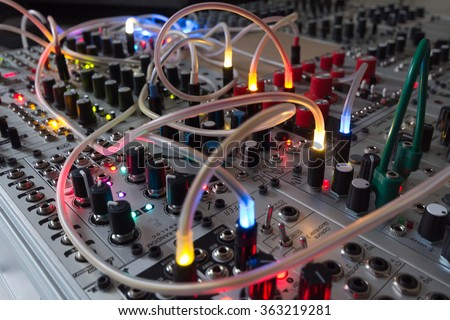 analog synthesizer - blinking lights on music equipment - stock photo