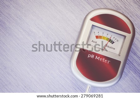 analog tool to measure soil ph on a light tint wood background - stock photo