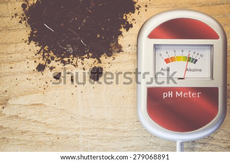 analog tool to measure soil ph on an old natural tint wood background - stock photo