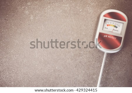 analog tool to measure soil ph on anatural stone background - copy space - stock photo