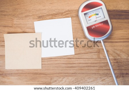 analog tool to measure soil ph on anatural wood background - blank memo copy space - stock photo