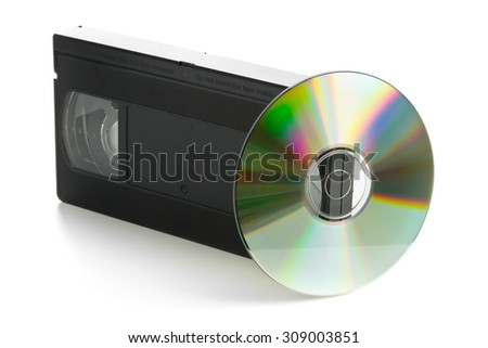 Analog video cassette with DVD disc - old movies backup or transfer concept - stock photo