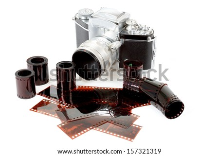 analog vintage SLR camera and color negative films on white background - stock photo