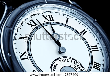 Analog wrist watch closeup at five to twelve - stock photo