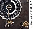 Analogue Clock Timer: Closeup of an old metal analogue clock timer set to five o'clock. Wires and gears are visible. - stock photo