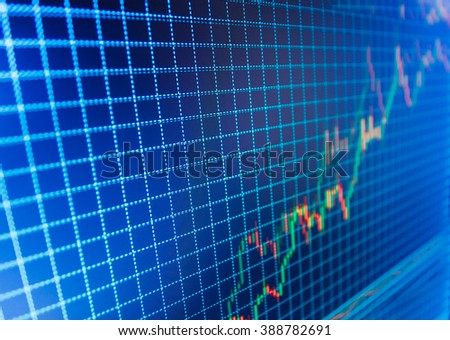 Analysing stock market data on a monitor. Market report on blue background. Business analysis diagram. Financial graph on a computer monitor screen. World economics graph. Stock analyzing.   - stock photo
