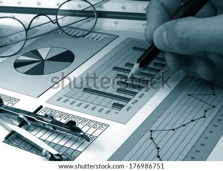 Analysis of bussiness graphs monochrome in blue - stock photo
