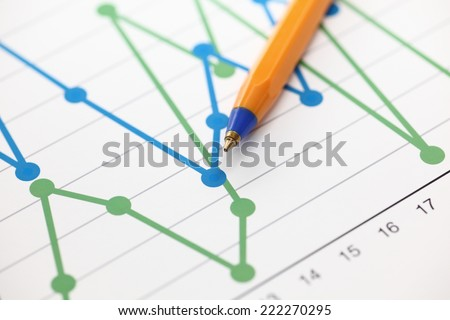 Analysis of financial statements (Line Graph). Business graph and ballpoint pen. Close-up. - stock photo