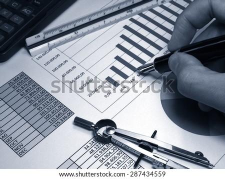 Analysis of sales graphs monochrome - stock photo