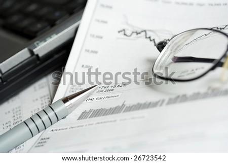 Analysis of the stock market reports. - stock photo