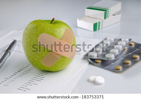 analysis results and prescription drug on a table - stock photo