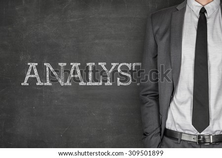 Analyst on blackboard with businessman in a suit on side