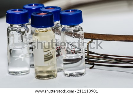 Analytical chemistry sample vial (blue screw cap) with column