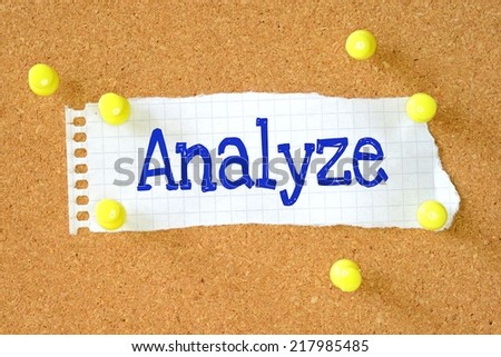 Analyze handwritten on torn paper pinned on cork board - stock photo