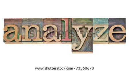 analyze - isolated word in vintage wood letterpress printing blocks stained by colorful inks - stock photo
