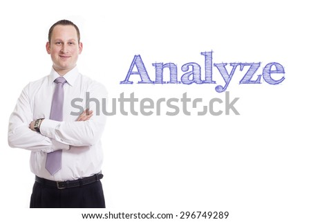 Analyze Young businessman with blue text isolated on white background - stock photo